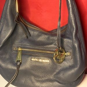 Navy blue purse with dust bag